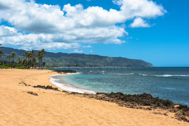 Sand beach along North Shore, Oahu. A view of a sand beach along the coast of North Shore, Oahu, Hawaii stock photography