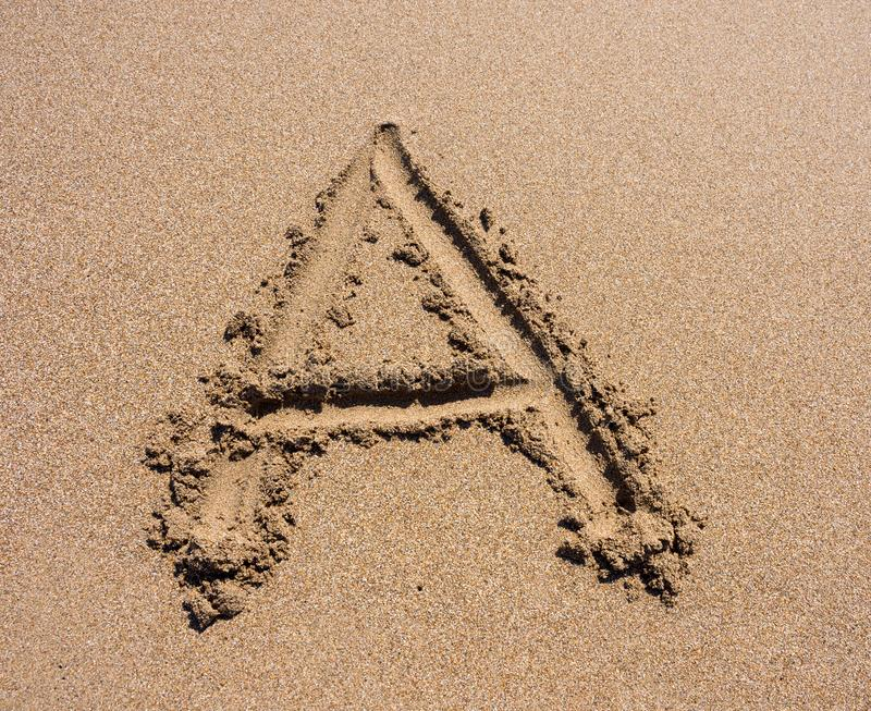 Alphabet`s letter A handwritten in sand on the beach. Sand Beach Alphabet: Letter A. Alphabet`s letter A handwritten in sand on the beach stock images