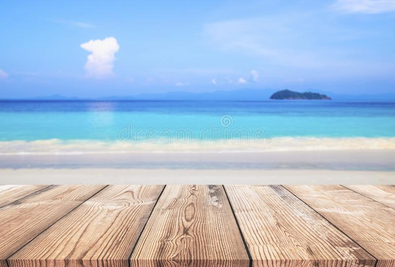 Wood table with blue sea and sand beach background royalty free stock photos