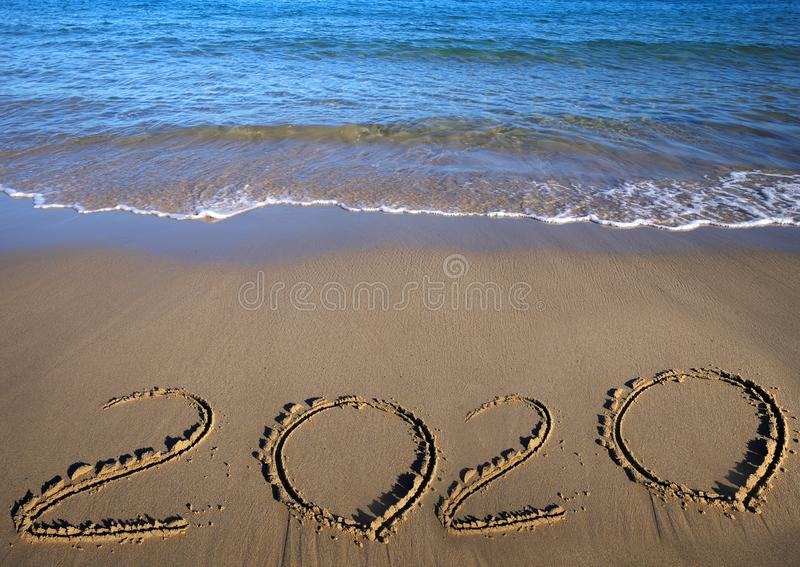 Sand beach drawing 2020. Happy New 2020 Year. Merry Christmas and Happy New Year. Background. Sea and sand beach. Copy royalty free stock photography