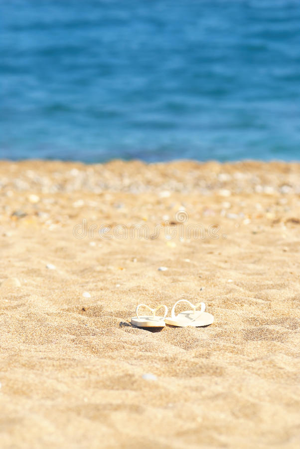 Download Sand blue sea and slippers stock photo. Image of sandals - 13057660