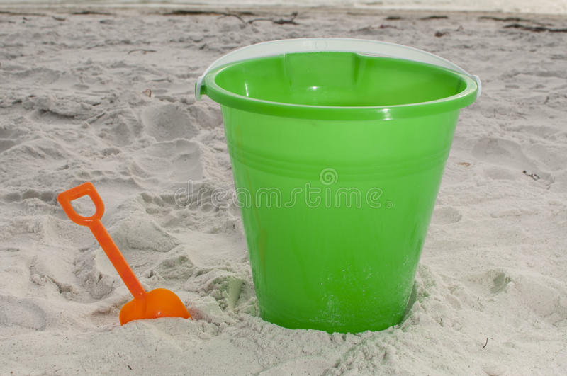 Sand bucket at the beach stock image
