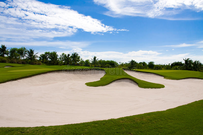 Sand bunker in the golf course stock photo