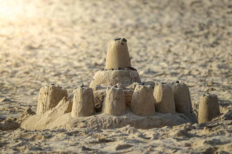 Sand castle on the beach. Concept for happy family vacation royalty free stock photography