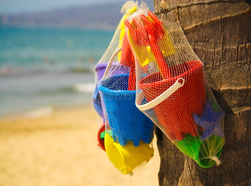 Sand Castle Building Tools Just Hanging Around Waiting to be Picked Up royalty free stock image