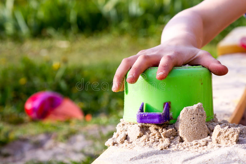 Sand castle in the children`s sandbox stock images