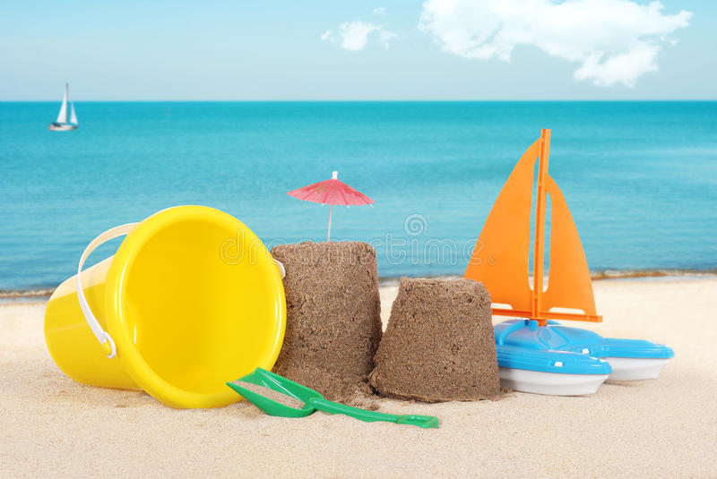 Sand castle with toys royalty free stock photography