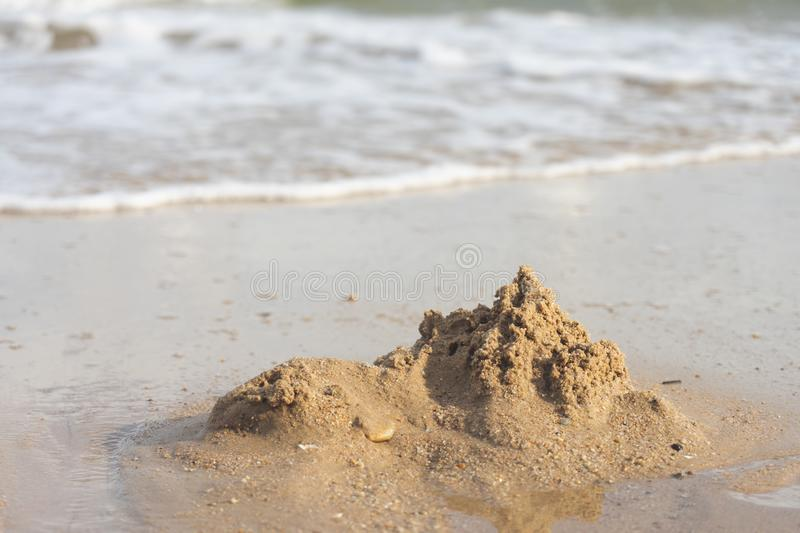 Sand castles destroyed by sea water But the remains of the ruined soil Summer concept Unsustainable and uncertain royalty free stock photo