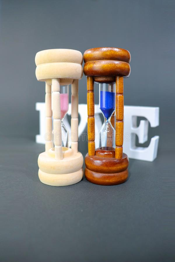 Sand clock. Parallel worlds exist at the same time in each couple royalty free stock photos
