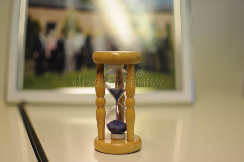 Sand clock on the table. Time is running stock photo