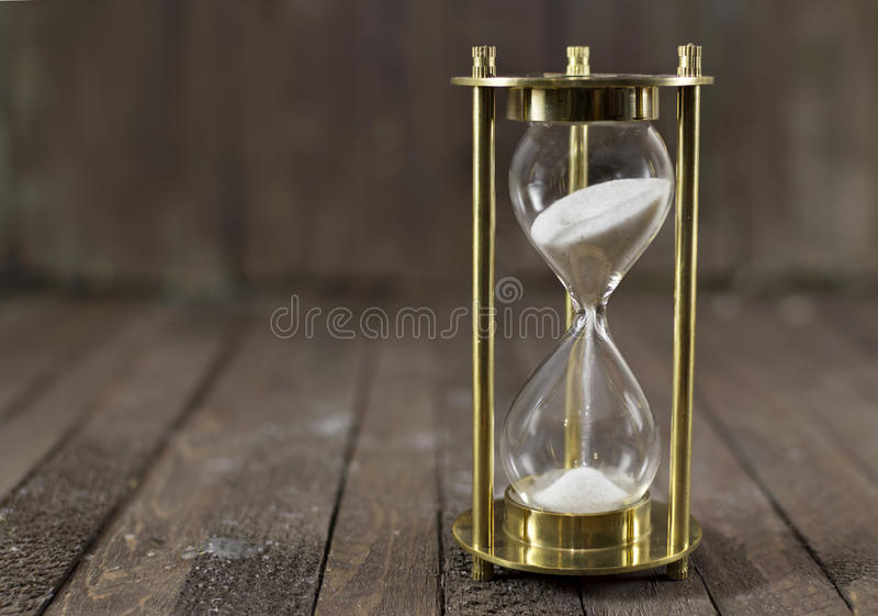 Sand clock on wood royalty free stock images
