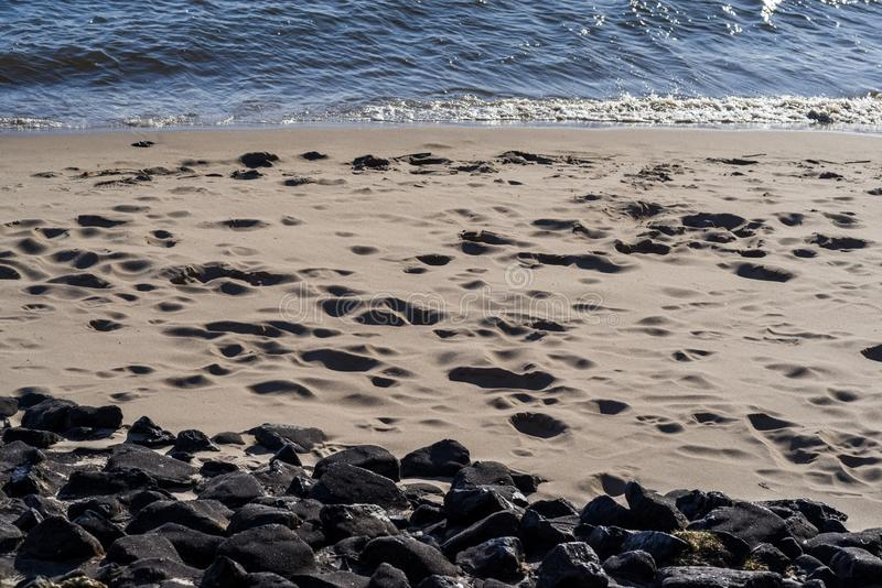Calm waves on the sand coast royalty free stock image