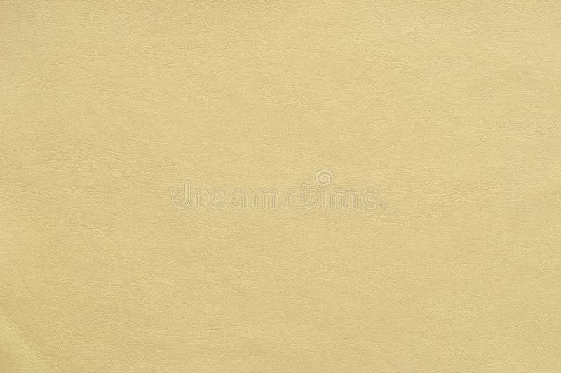 Sand colored faux leather with a fine texture. Sand colored faux leather with a fine texture, background royalty free stock photos