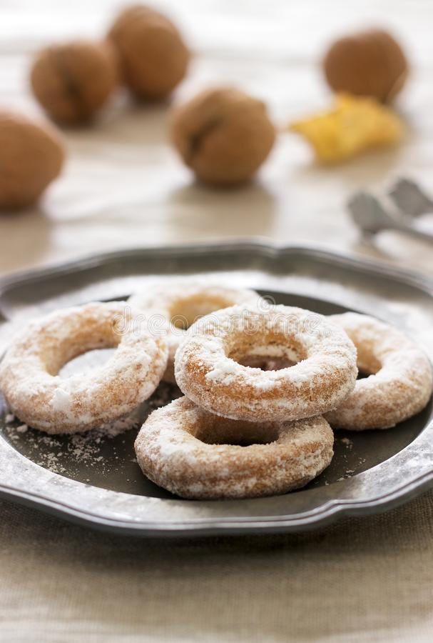 Sand dough biscuits, coffee and walnuts on a linen tablecloth. Rustic style. royalty free stock photo