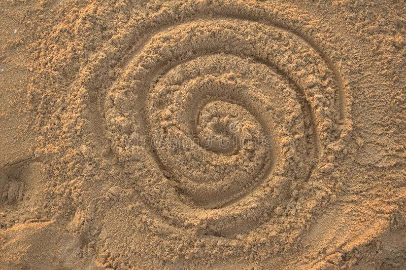 Sand drawing. A sand draw of a dreamtime logo in atlit city stock images