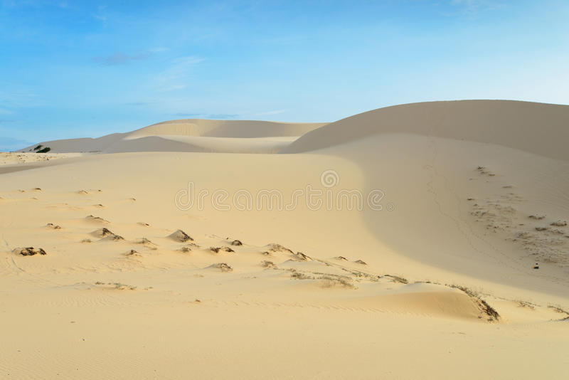Sand dune and blue sky in Muine, Vietnam. The sand dune and blue sky in Muine, Vietnam stock photography