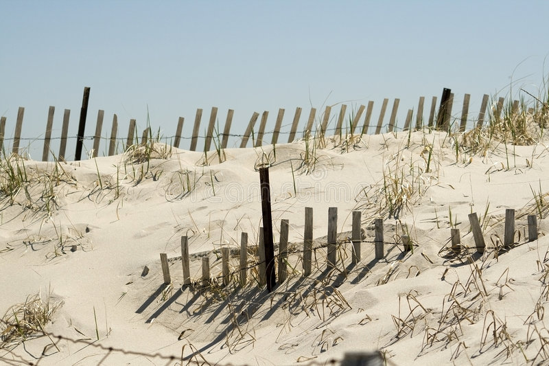 Sand dune and fence royalty free stock image