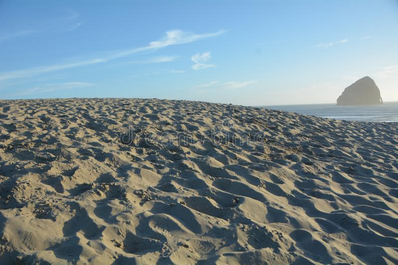 Sand dune and Haystack Rock, Pacific City, Oregon Coast stock images