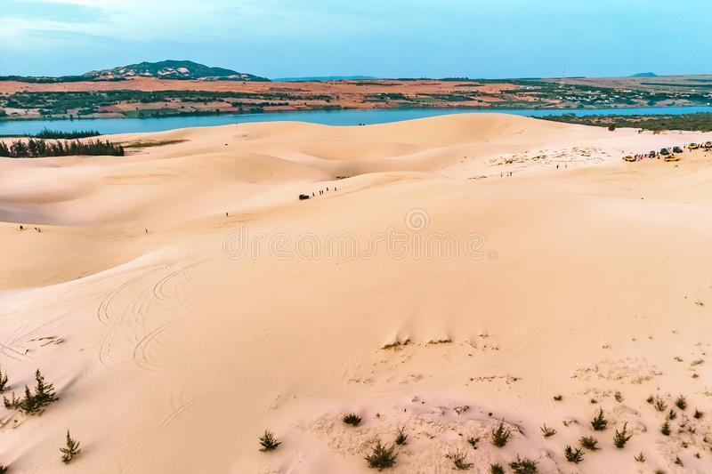 sand dune in Mui Ne, Vietnam. Beautiful sandy desert landscape. Sand dunes on the background of the river. Dawn in the sand dunes stock images