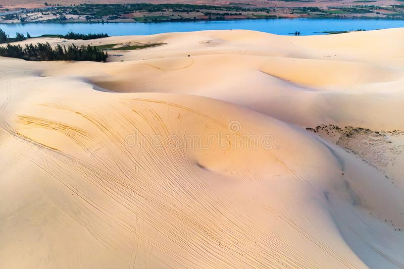 Sand dune in Mui Ne, Vietnam. Beautiful sandy desert landscape. Sand dunes on the background of the river. Dawn in the sand dunes. Of MUI ne stock images