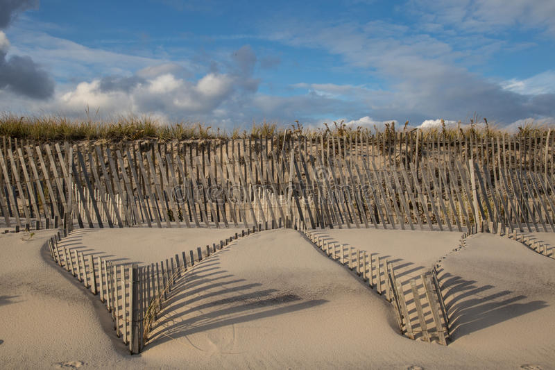 Sand dune windswept fences shadows. Sand Dune fences in East Hampton, New York, Main Beach royalty free stock photography