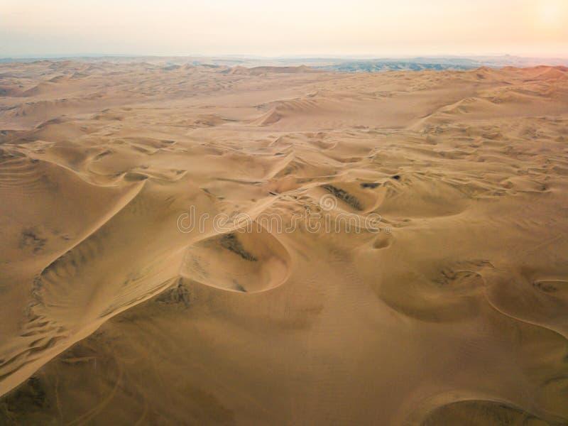 Sand dunes aerial panorama. Sand dunes of Huacachina Peru aerial panorama desert south america dry arid empty nothing hot scorching landscape stripes horizon royalty free stock image
