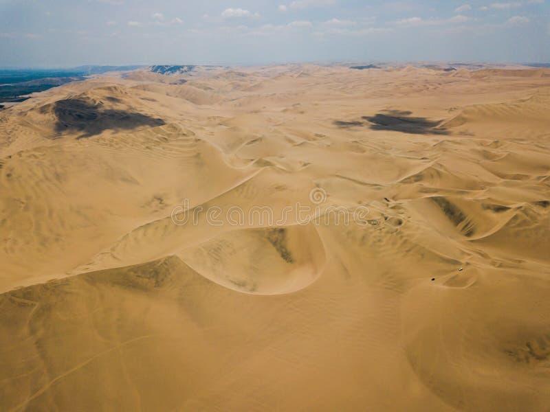 Sand dunes aerial panorama. Sand dunes of Huacachina Peru aerial panorama desert south america dry arid empty nothing hot scorching landscape stripes horizon stock photography