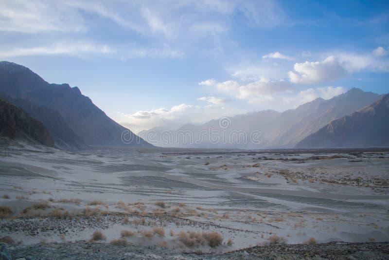 Sand dunes barren cold desert ladakh high altitude. White, valley, textured, ripple, waves, shapes, travel, india, sand-dune, nubra, dig, landscape, kashmir royalty free stock images
