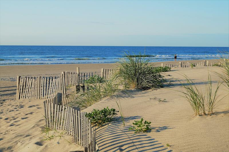 Sand dunes, beach, blue sky stock image