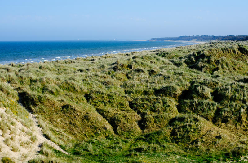 Sand Dunes and beach in Wexford. Dune system in Wexford , Ireland, beautiful beaches Blue Flag beach and green coast with warm, golden sand and blue sea stock photography