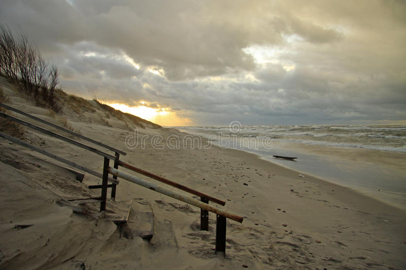 Sand dunes of the Curonian Spit at sunset, Kaliningrad Oblast, Russia. Sand dunes of the Curonian Spit at sunset, the Baltic Sea, Kaliningrad Oblast, Russia royalty free stock photo