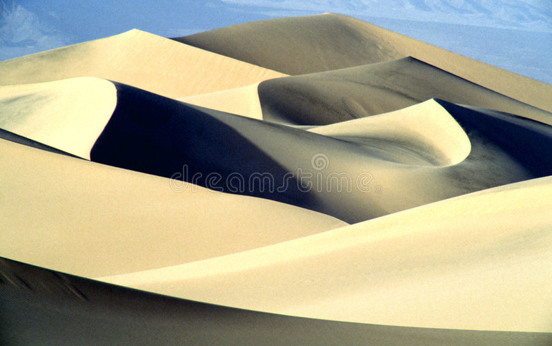 Sand dunes in desert. Beautiful desert landscape, sand structures and deep blue sky royalty free stock images