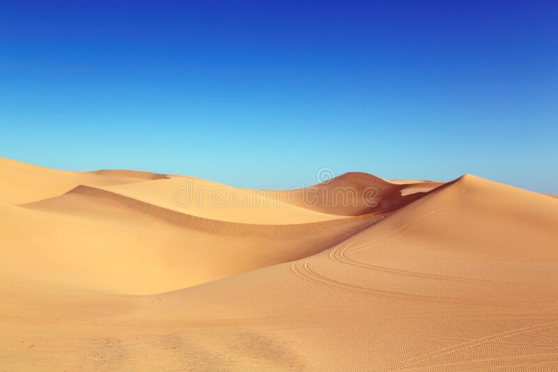 Sand dunes in the desert stock photography