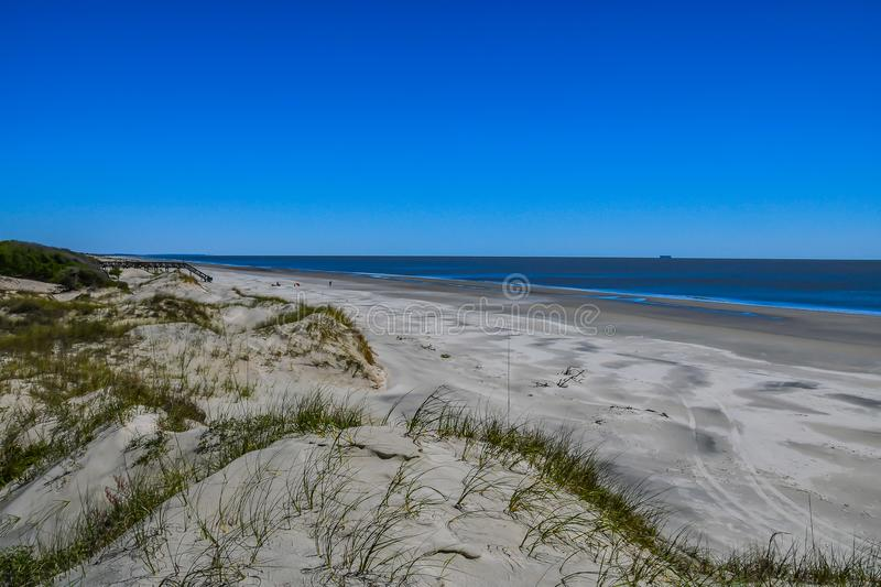 Sand Dunes and a Freighter royalty free stock photos