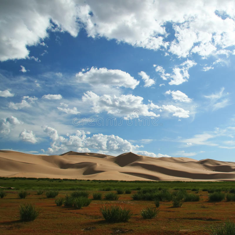 Sand dunes in gobi desert in mongolia. Clouds and sand dunes in gobi desert in mongolia royalty free stock photography