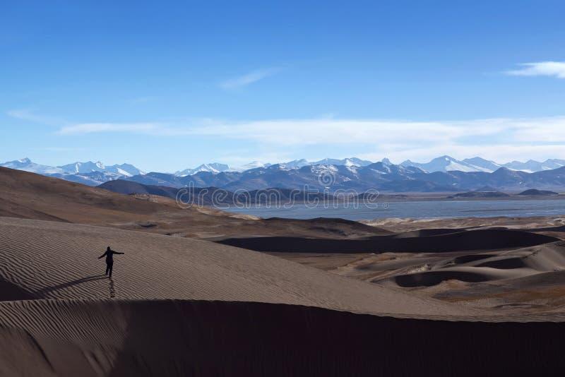 Sand dunes and Himalayas along China-Nepal Border, Tibet royalty free stock photos