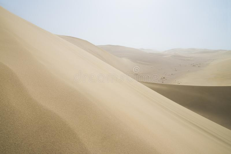 Sand dunes and waves in Gobi Desert in China, Gobi Desert, China. Sand dunes landscape and waves of sand in the Gobi Desert in China, Gobi Desert, China royalty free stock images