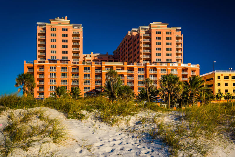 Sand dunes and large hotel in Clearwater Beach, Florida. Sand dunes and large hotel in Clearwater Beach, Florida royalty free stock photo