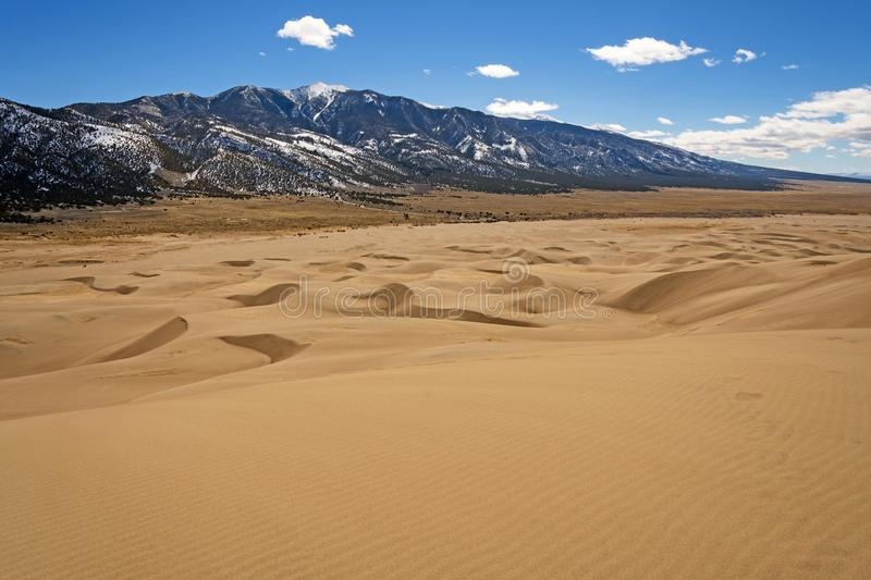 Sand Dunes Leading to the Mountains stock photography