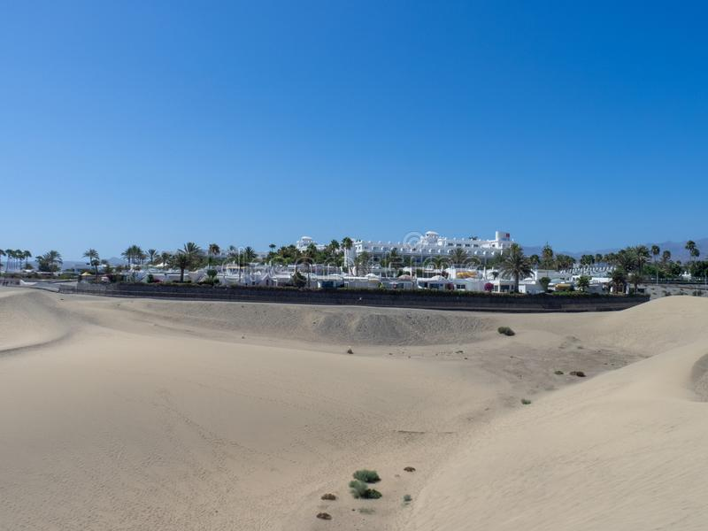 Sand dunes at Maspalomas, Gran Canaria. Gran Canaria/Spain - August 13 2019: Sand dunes at Maspalomas. Maspalomas is a tourist town in the south of the island of stock images