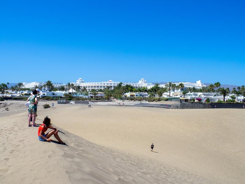 Sand dunes at Maspalomas, Gran Canaria. Gran Canaria/Spain - August 13 2019: Sand dunes at Maspalomas. Maspalomas is a tourist town in the south of the island of royalty free stock photo