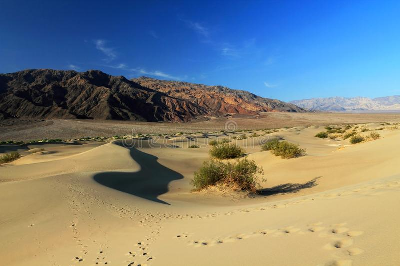 Desert Landscape of Sand Dunes and Barren Panamint Mountains at Mesquite Flat, Death Valley National Park, Inyo CouCalifornia, USA royalty free stock images