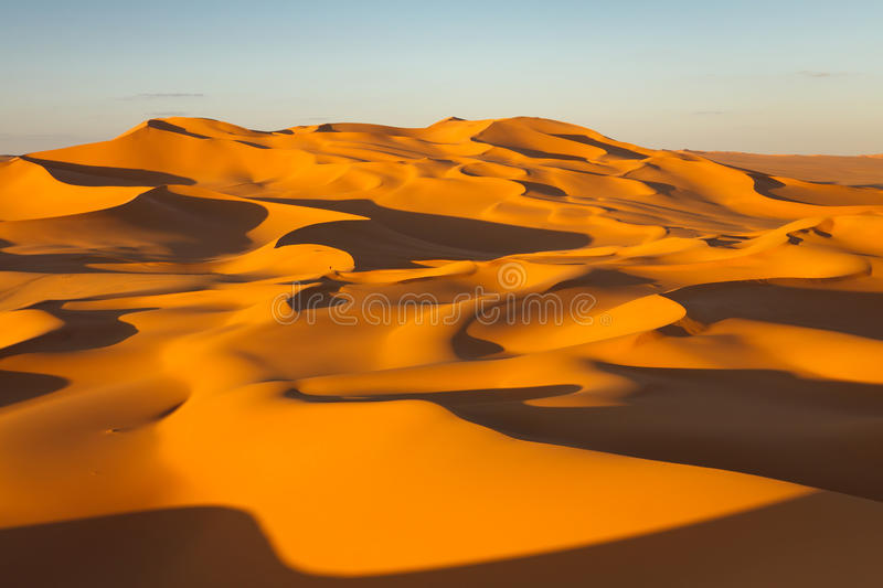 Sand Dunes - Murzuq Desert, Sahara, Libya. Endless sand dunes at sunset - Murzuq Desert, Sahara, Libya royalty free stock photos