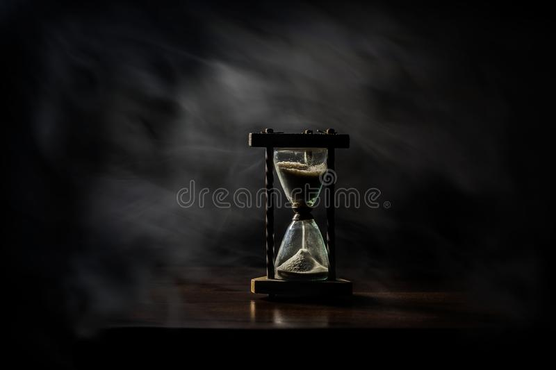 Sand glass, hour glass, minute glass. Time goes by. Passing, time out, runs off. stock image