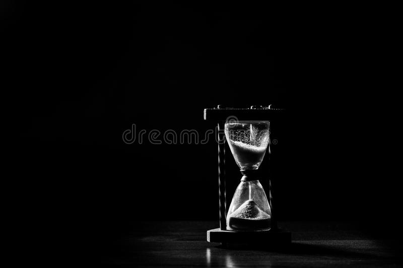 Sand glass, hour glass, minute glass. Time goes by. Passing, time out, runs off. Sand glass or hour glass or minute glass, time goes by. Passing, time out, runs royalty free stock photos