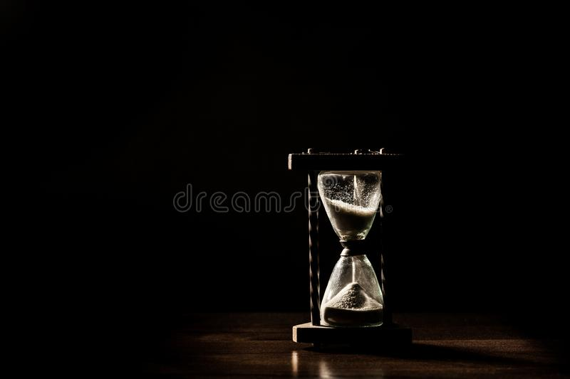 Sand glass, hour glass, minute glass. Time goes by. Passing, time out, runs off. Sand glass or hour glass or minute glass, time goes by. Passing, time out, runs stock image