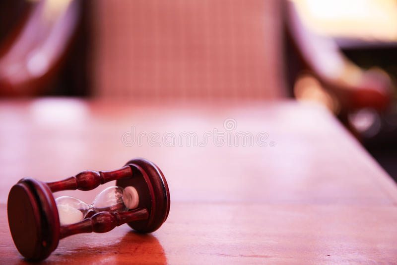 Sand glass or hourglass put wooden table stock photos