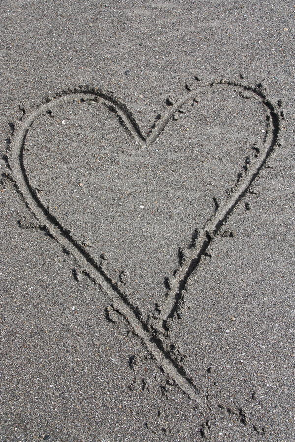 Sand Heart. Heart drawn in sand at beach royalty free stock photos