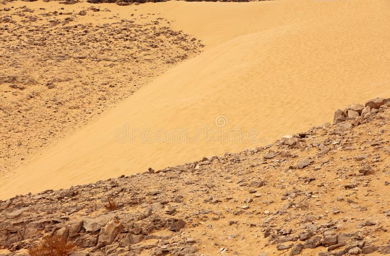 Sand hills and stones In the desert royalty free stock photography