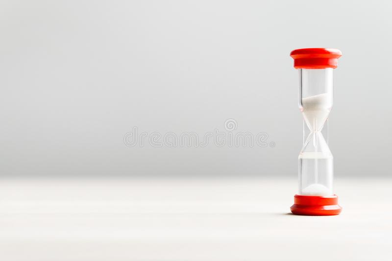 Sand in hourglass. Time passing concept. royalty free stock image